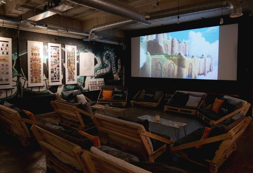 Relaxed auditorium area showing silent films